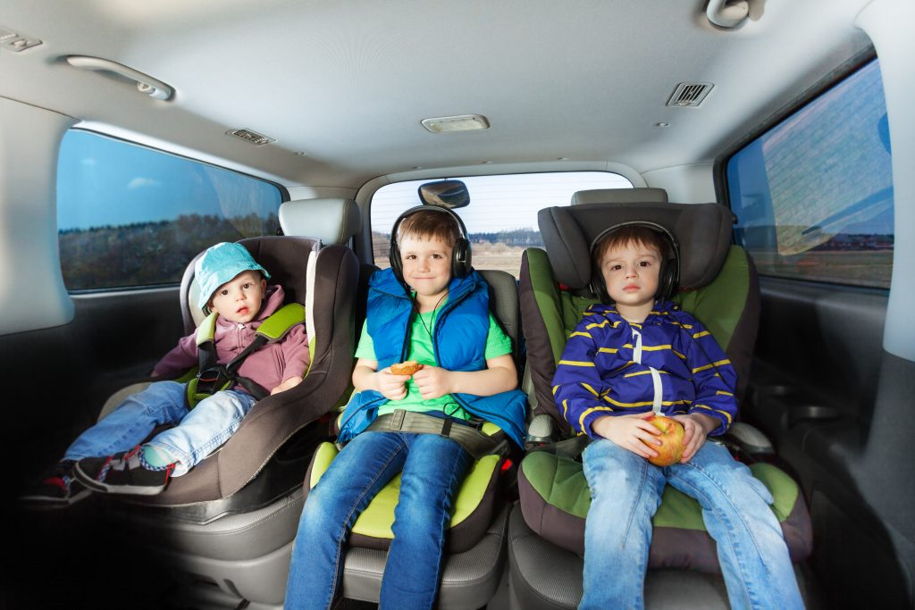 brothers in car seats during travel
