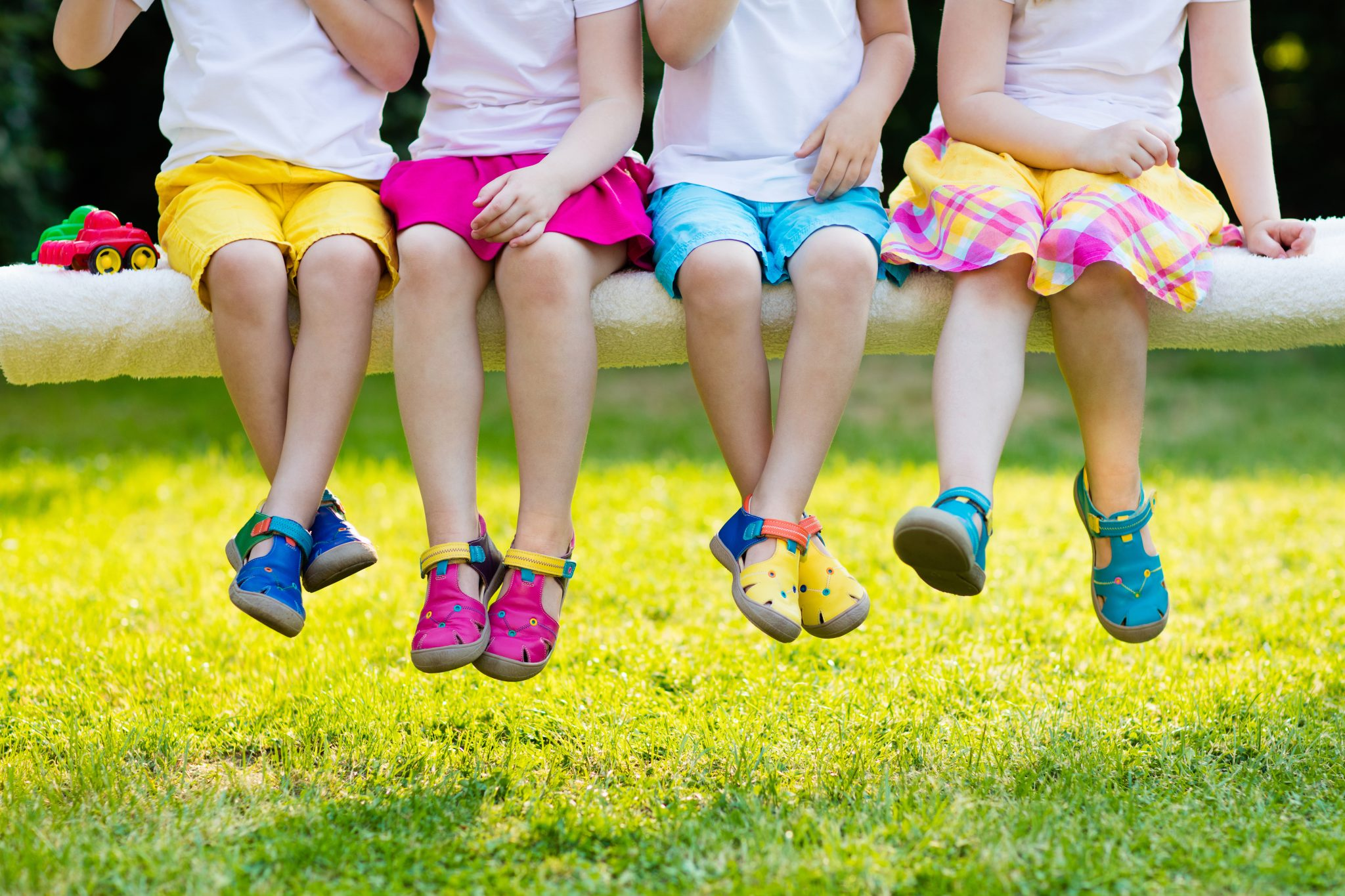 Group of preschool kids wearing colorful shoes.