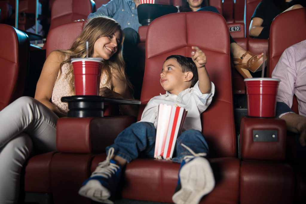 Hispanic boy excited about a movie