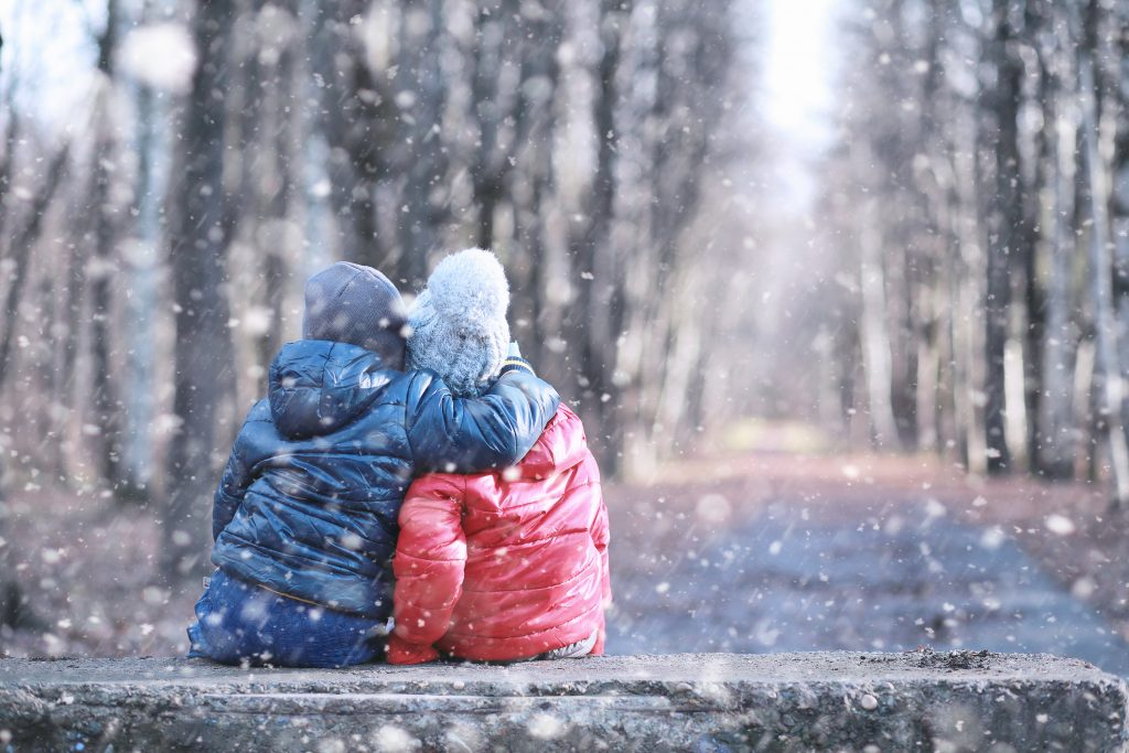 Kids walk in the park with first snow