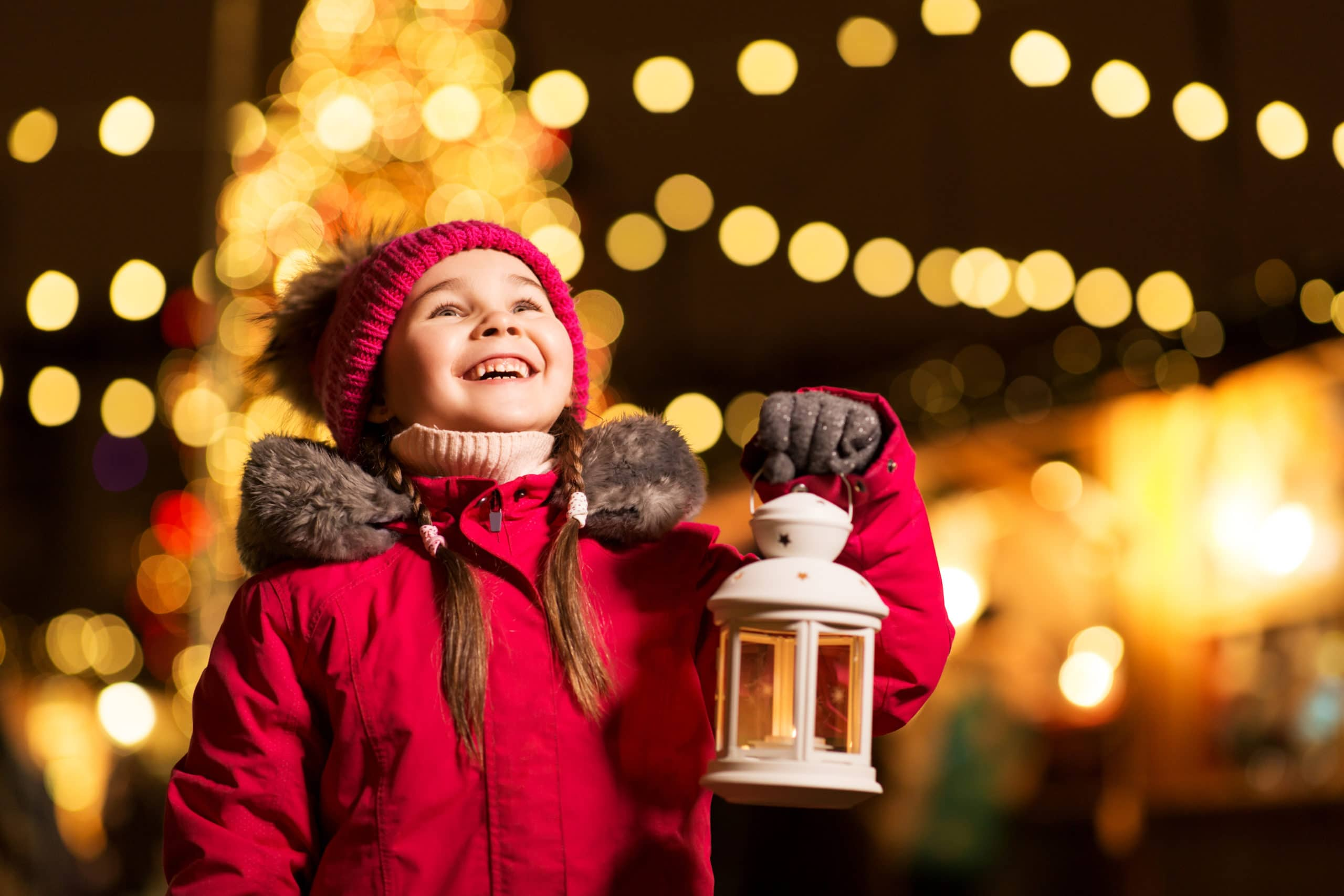 A young girl at a holiday lights display