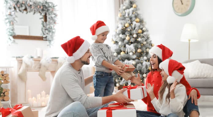 A happy family opening Christmas gifts